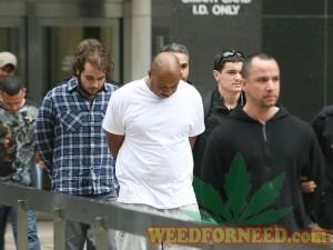 "Matthew Stang (left) preceded byKareem ""Biggs"" Burke and alleged ringleader ""Manny"" Perez"